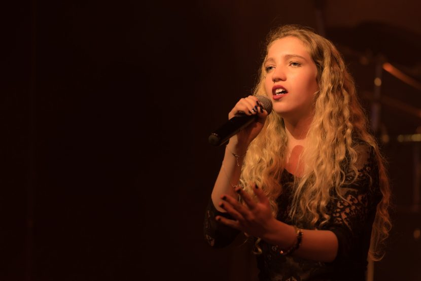 Female vocalist performs on stage.
