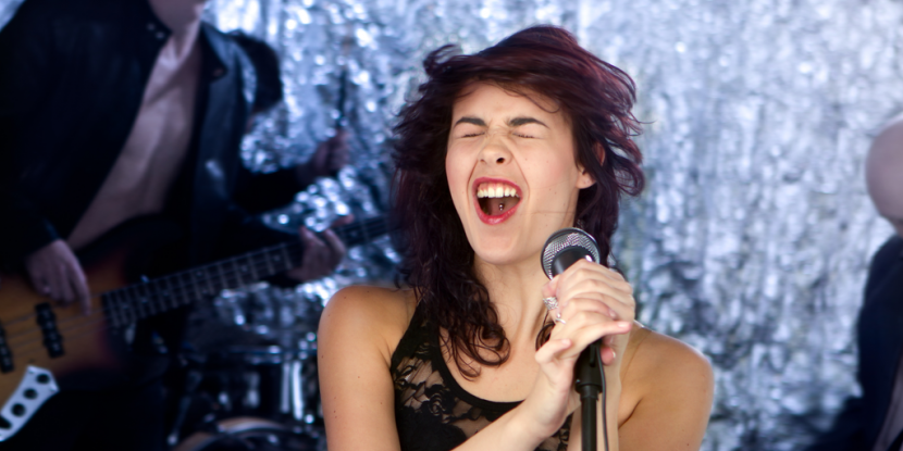 Lead female vocalist belting a high note