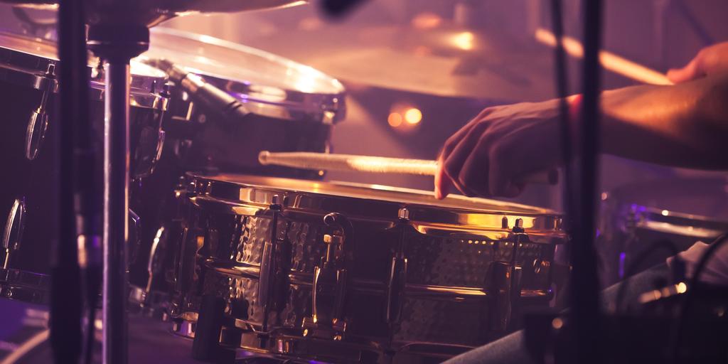 Man plays the drum kit
