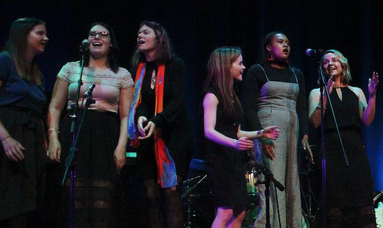 Vocal ensemble sing choir song together.