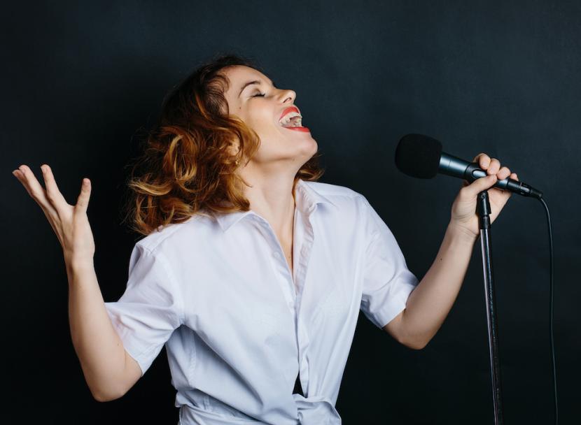 Female singer practices her breathing technique.