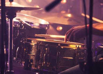 Man plays drum kit