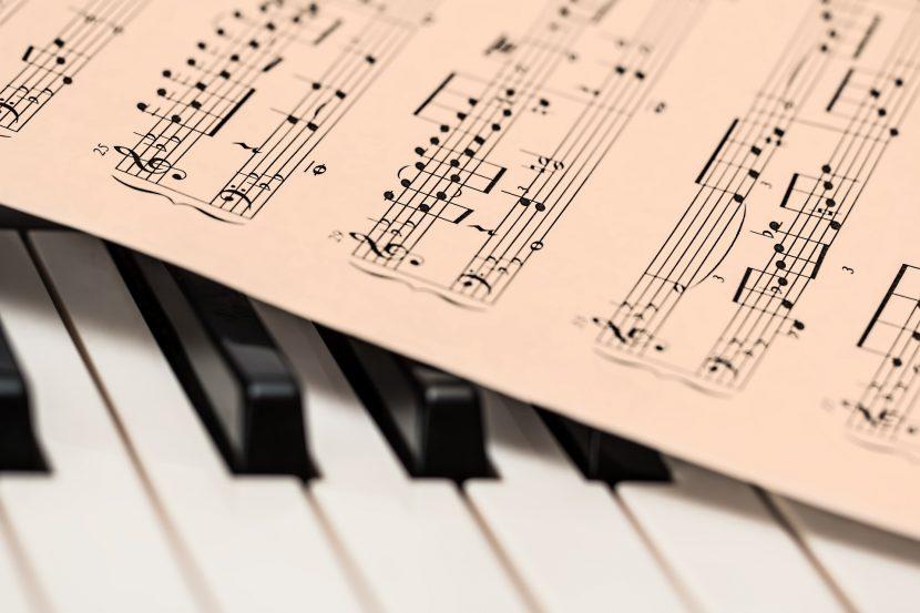 A score lays on piano keys.