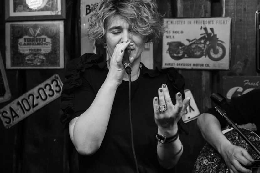 Female vocalist sings with band.