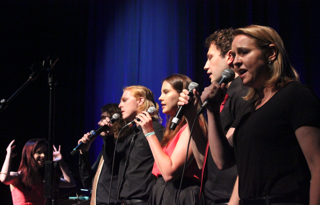 Sono Music Vocal Ensemble perform on stage.